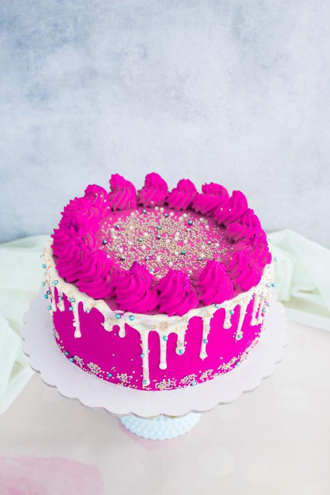 Sprinkles Drip Cake pistacchio e lamponi procedimento