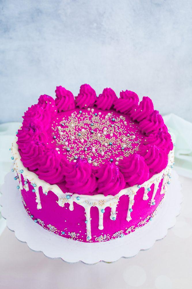 Sprinkles Drip Cake pistacchio e lamponi ricetta
